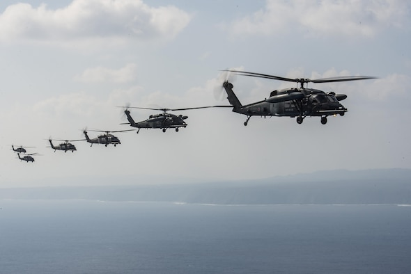 HH-60 Pave Hawks from 33rd Rescue Squadron, 943rd Rescue Group and Japan Air Self-Defense Force, fly in formation behind an MC-130J from the 17th Special Operations Squadron during exercise Keen Sword 17, Nov. 7, 2016, near Okinawa, Japan. The U.S.-Japan mutual security treaty is a symbol of the U.S. commitment to Japan and the region and allows the U.S. to provide forward-based forces that can rapidly react to counter aggression against Japan and other allies and partners. . (U.S. Air Force photo by Senior Airman Stephen G. Eigel/released)