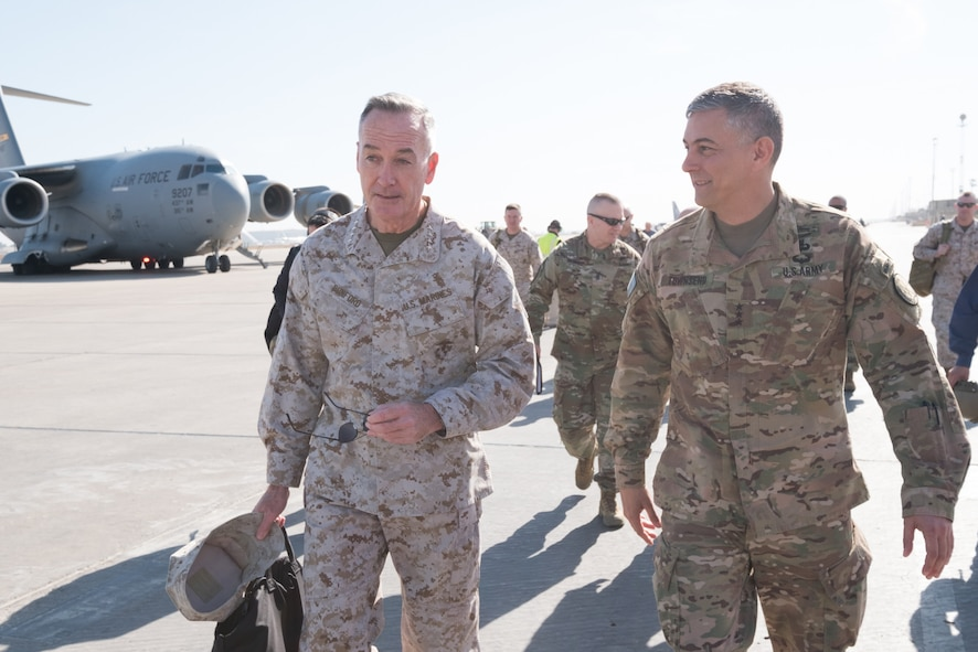 Marine Corps Gen. Joe Dunford, chairman of the Joint Chiefs of Staff, talks with by Army Lt. Gen. Stephen J. Townsend, commander of Combined Joint Task Force Operation Inherent Resolve.