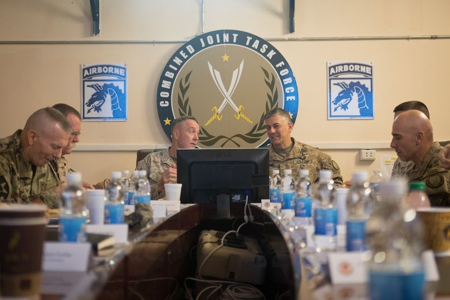 Marine Corps Gen. Joe Dunford., chairman of the Joint Chiefs of Staff, and Army Lt. Gen. Stephen J. Townsend, commander of Combined Joint Task Force Operation Inherent Resolve, meet with staffers in Baghdad.