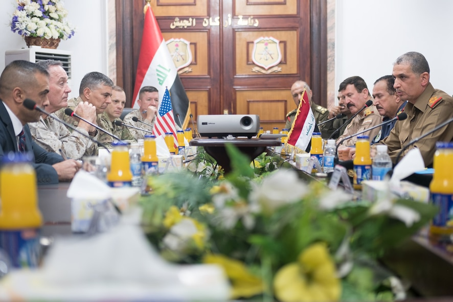 Marine Corps Gen. Joe Dunford, second from left, chairman of the Joint Chiefs of Staff, and Army Lt. Gen. Stephen J. Townsend, commander of Combined Joint Task Force Operation Inherent Resolve, meet with Iraqi chief of defense Lt. Gen. Othman al-Ghanimi and members of his staff.