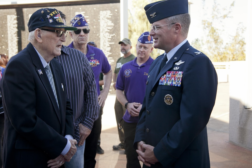 U.S. Air Force retired Senior Master Sergeant Chester Stafford, World War II, Korean and Vietnam veteran speaks with Col. Paul Murray, 99th Air Base Wing commander, Nellis Air Force Base, Nev. the City of Henderson Veterans Memorial Wall during a Veterans Day celebration, Nov. 5.  In 1954, President Dwight D. Eisenhower changed Armistice Day to Veterans Day, in order for Americans to pay homage to veterans of all foreign wars.  (U.S. Air Force photo by Lawrence Crespo)