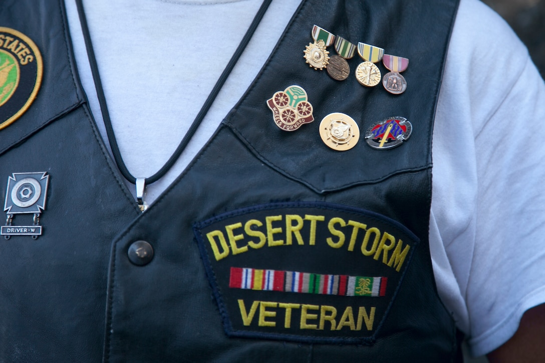 A Desert Storm veteran proudly displays his earned service medals during the City of Henderson, Nev. Veterans Day celebration, Nov. 5.  Veterans Day recognizes all Airmen, Soldiers, Marines, Sailors and Coast Guardsmen who served the United States selflessly. (U.S. Air Force photo by Lawrence Crespo)