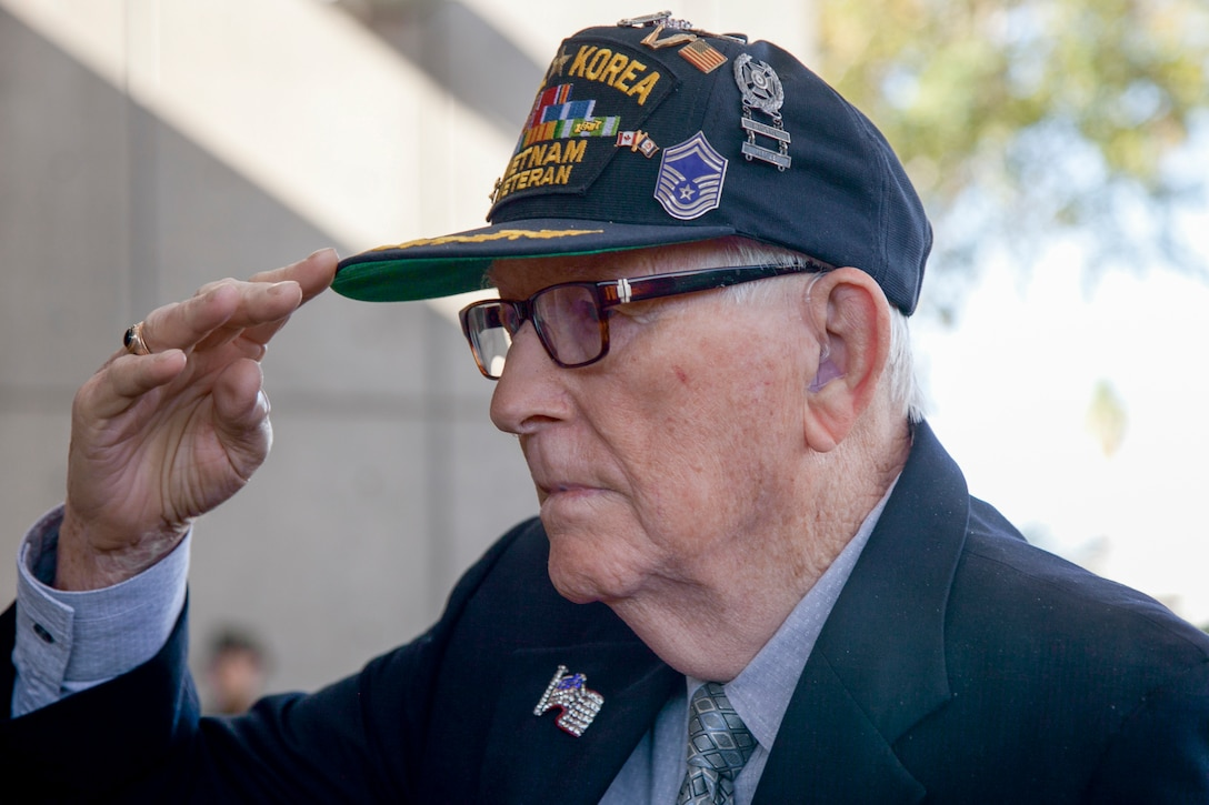 Retired Air Force Senior Master Sgt. Chester Stafford, a veteran of World War II, Korean and Vietnam Wars, renders a salute during a Veterans Day ceremony in Henderson, Nev., Nov. 5. Air Force photo by Lawrence Crespo