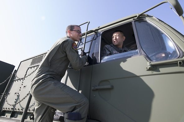 (Left to right) U.S. Air Force Senior Airman Nelson Jones, 535th Airlift Squadron C-17 loadmaster, and Japan Air Self-Defense Force Master Sgt. Shiro Suzuki, 10th Fire Unit Chitose Air Base, check a JASDF Electric Power Plant vehicle before loading onto a C-17 Globemaster III at Yokota Air Base, Japan, Nov. 6, 2016, during the exercise Keen Sword 2017. Units from the U.S. military conduct training with their Japan Self-Defense Forces counterparts at military installations throughout Japan, the Mariana Islands and in the surrounding waters. (U.S. Air Force photo by Yasuo Osakabe/Released)
