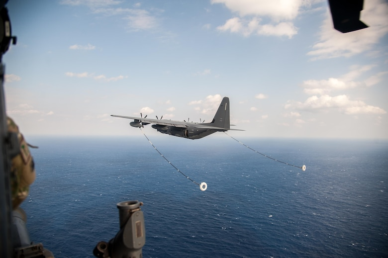 A U.S. Air Force MC-130J Commando II from the 17th Special Operations Squadron prepares to perform in-flight refueling with a HH-60G Pave Hawk helicopter assigned to the 33rd Rescue Squadron Nov. 4, 2016, off the coast of Okinawa, Japan. Keen Sword is a regularly scheduled exercise which strengthens Japan-U.S. military interoperability and meets mutual defense objectives. Japan-U.S. military operations and exercises increase readiness to respond to varied crisis situations in the region. (U.S. Air Force photo by Senior Airman John Linzmeier)