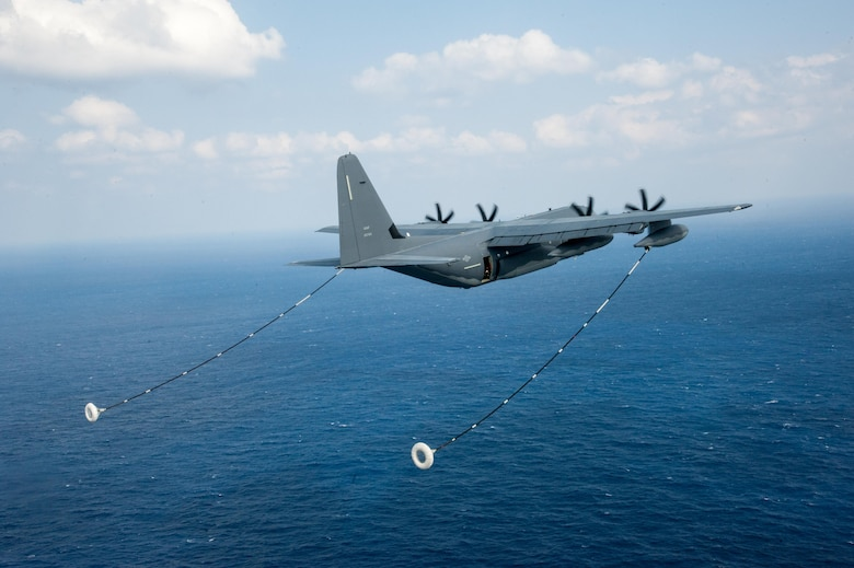 A U.S. Air Force MC-130J Commando II from the 17th Special Operations Squadron prepares to perform in-flight refueling with a HH-60G Pave Hawk helicopter assigned to the 33rd Rescue Squadron Nov. 4, 2016, off the coast of Okinawa, Japan, for the annual exercise Keen Sword. The fundamental role of U.S. forces in Japan is to deter aggression and maintain peace and security in the region, and is an essential component of the U.S.-Japan alliance. (U.S. Air Force photo by Senior Airman John Linzmeier)