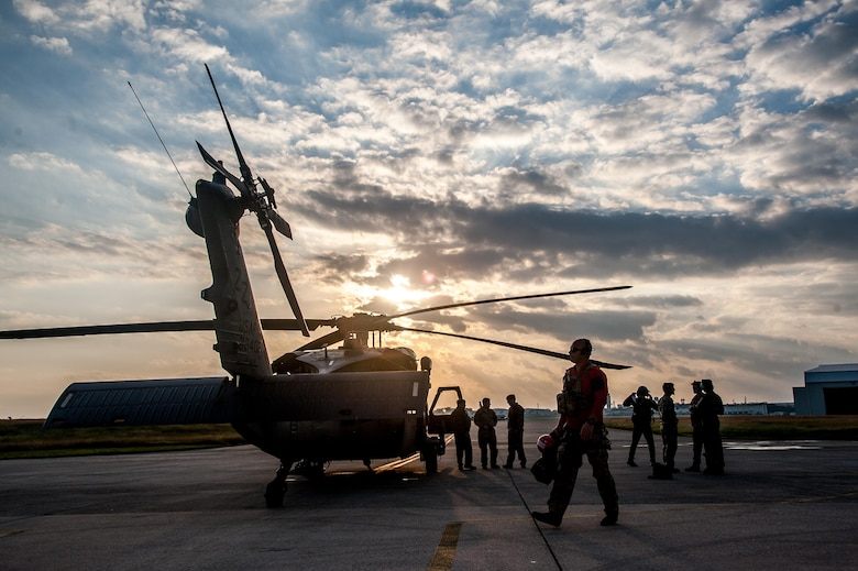 U.S. Air Force Airmen prepare to board an HH-60G Pave Hawk helicopter assigned to the 33rd Rescue Squadron during annual exercise Keen Sword Nov. 4, 2016, on Kadena Air Base, Japan. Keen Sword is a regularly scheduled exercise which strengthens Japan-U.S. military interoperability and meets mutual defense objectives. Japan-U.S. military operations and exercises increase readiness to respond to varied crisis situations in the region. (U.S. Air Force photo by Senior Airman John Linzmeier)