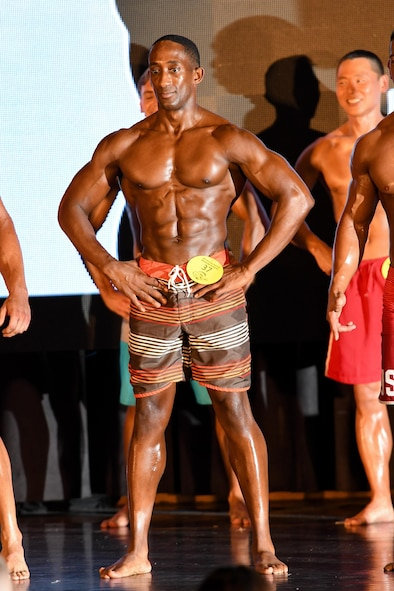 "U.S. Air Force Tech. Sgt. Quinton Beach, 51st Munitions Squadron munitions control section chief, poses during the 2016 Mustang Mania Bodybuilding Competition on Osan Air Base, Republic of Korea, Nov. 5, 2016. Beach won the male physique 5'11"" and below category during the competition. (U.S. Air Force photo by Staff Sgt. Jonathan Steffen)"