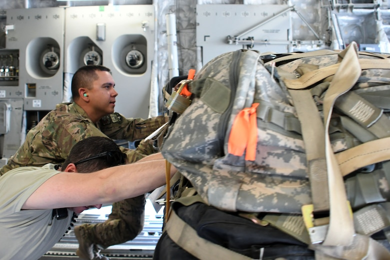 Tech Sgt. Ronald Gowen, a logistician assigned to the 387th Air Expeditionary Squadron, assists aerial porters with unloading a C-17 Globemaster III at an undisclosed location in Southwest Asia Nov. 4, 2016. Gowen is currently embedded with  the 386th Expeditionary Logistics Readiness Squadron as he awaits transfer to a joint unit. (U.S. Air Force photo/Senior Airman Andrew Park)