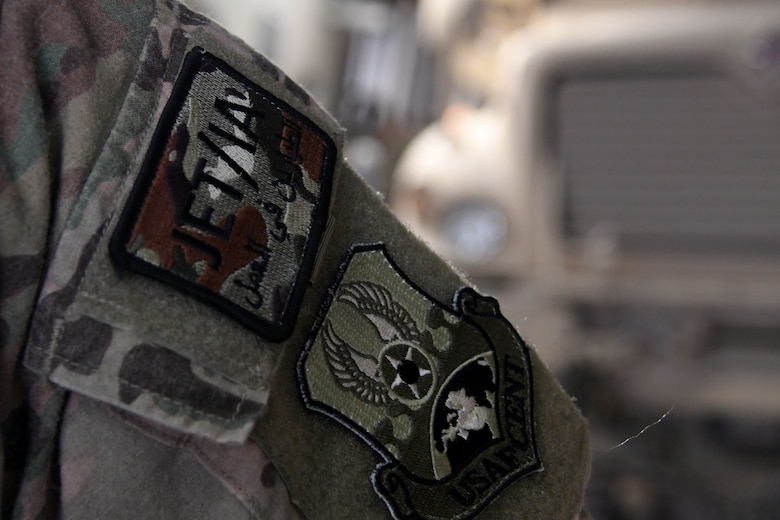 A JET/IA patch is affixed to the uniform of Tech Sgt. Ronald Gowen, a logistician assigned to the 387th Air Expeditionary Squadron.  The 387th Air Expeditionary Squadron is responsible for more than 300 of these Joint Expeditionary Tasking and Individual Augmentee Airmen, who are currently deployed in 10 to 12 different countries. (U.S. Air Force photo/Senior Airman Andrew Park)