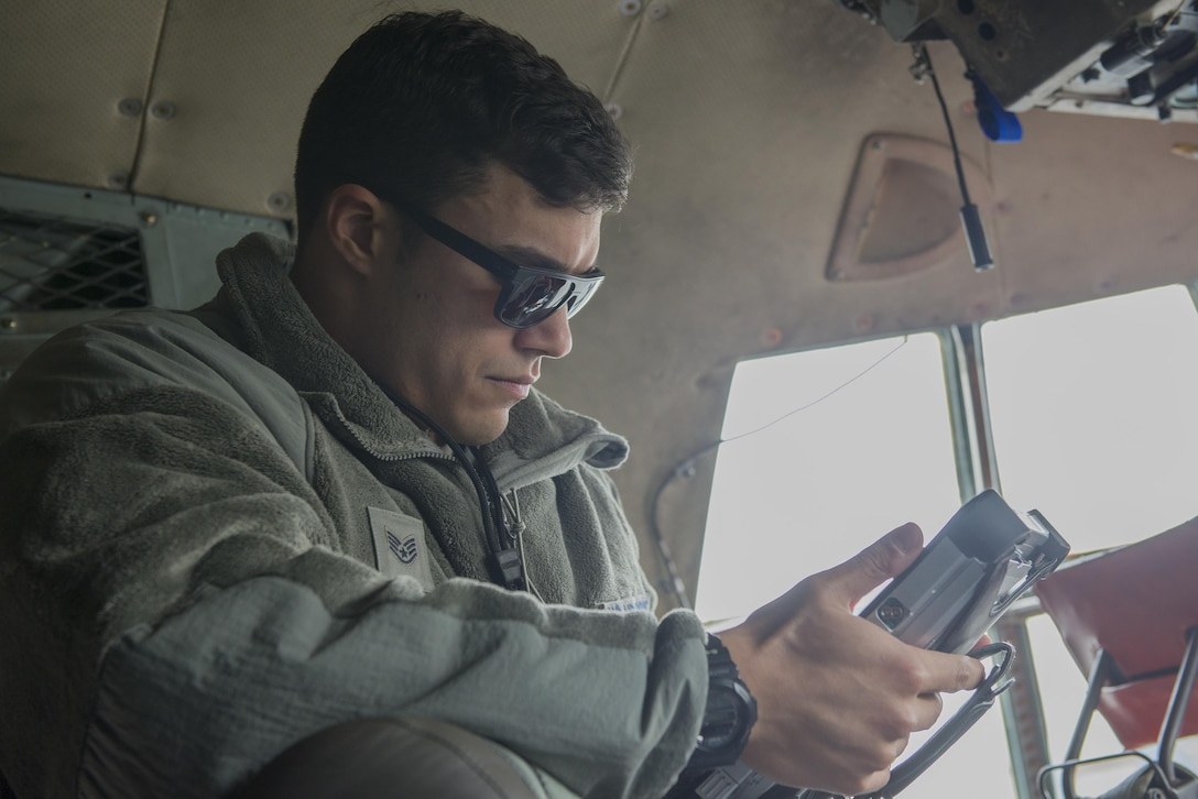 Staff Sgt. Richard Martinez, 374th Maintenance Squadron electrical and environmental journeyman, reviews technical orders while troubleshooting aboard a C-130 Hercules at Yokota Air Base, Japan, Nov. 8, 2016. The Air Force technical order system provides clear and concise instructions for safely operating and maintaining aircraft and equipment. (U.S. Air Force photo by Senior Airman David C. Danford/Released)