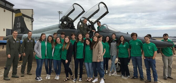 Tenth-grade students from local schools in the Lowndes Young Leaders program and 14th Flying Training Wing pilots pause for a photo Nov. 8, 2016, next to a T-38 Talon aircraft at Columbus Air Force Base, Mississippi. The students were hand-picked from more than 200 applicants to visit a variety of businesses and organizations in the local region to gain a better understanding of how various industries function. (U.S. Air Force photo by 1st Lt. Lauren Woods)