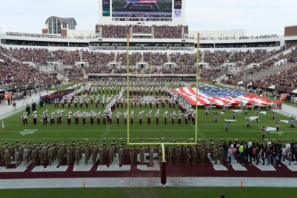Service members from active duty, guard, reserve and ROTC units around Mississippi wave a large American flag at the Mississippi State University football game Nov. 5, 2016. Nov. 5 is Military Appreciation Day and many service members came to watch the game free of charge. Among the events for Military Appreciation Day were a flyover from two T-38C Talon, a jersey presentation to the commander and vice commander of the 14th Flying Training Wing, and the announcement and a welcome home for a deployed Airman. (U.S. Air Force photo by Airman 1st Class John Day)