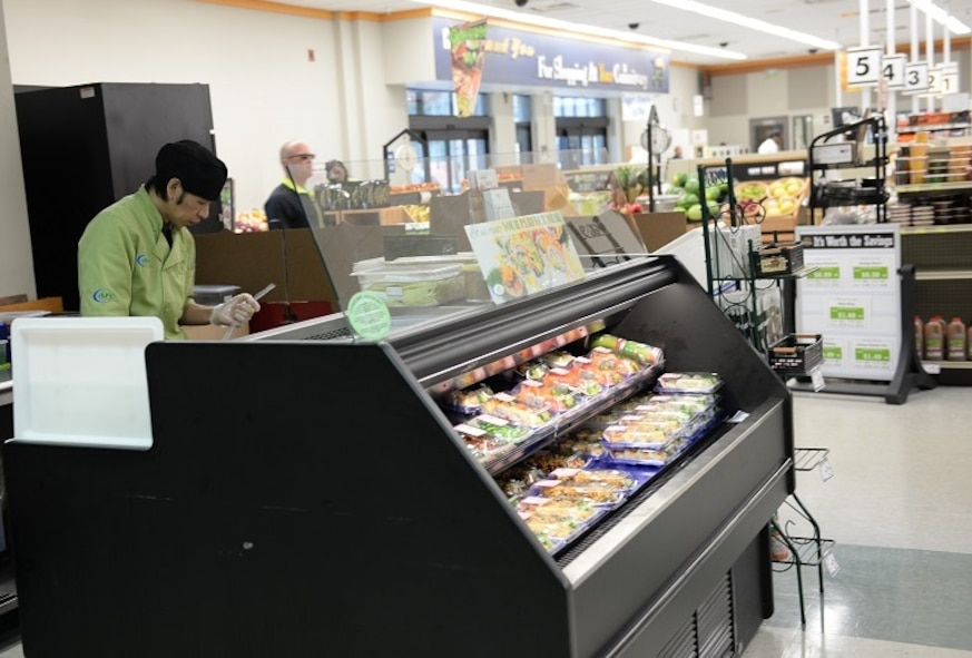 Saw Miller, sushi prep, rolls sushi Nov. 8, 2016, at the Columbus Air Force Base, Mississippi, Commissary. The sushi bar has moved from near the produce section to the area by the doors leading to the Base Exchange and food court. (U.S. Air Force photo by Airman 1st Class John Day)