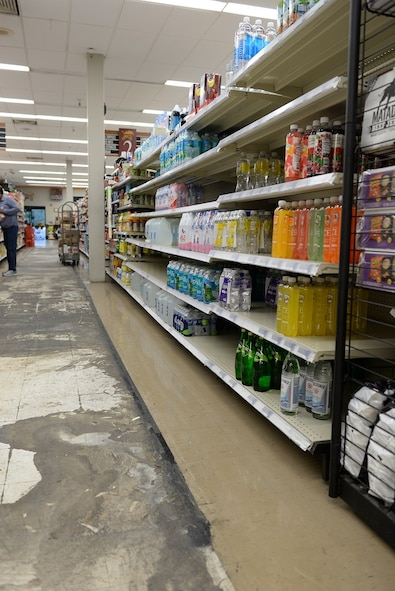 Energy drinks, water and popcorn products sit on the shelf of a new aisle at the Columbus Air Force Base, Mississippi, Commissary Nov. 8, 2016. By adding a new aisle, there is more room for the commissary to expand. (U.S. Air Force photo by Airman 1st Class John Day)