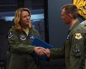 Secretary of the Air Force Deborah Lee James shakes, left, hands with U.S. Air Force Capt. Zachary Franklin, a B-2 Spirit pilot assigned to the 13th Bomb Squadron, after her B-2 Spirit flight debrief at Whiteman Air Force Base, Mo., Nov. 8, 2016. James had the opportunity to fly with Franklin during her B-2 flight. (U.S. Air Force photo by Senior Airman Danielle Quilla)
