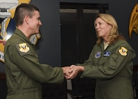 Secretary of the Air Force Deborah Lee James, right, receives a spirit coin from U.S. Air Force Brig. Gen. Paul W. Tibbets IV, the 509th Bomb Wing commander, at Whiteman Air Force Base, Mo., Nov. 8, 2016. During her post flight debrief, James observed first-hand the team work involved in ensuring each B-2 Spirit mission is conducted safely and successfully. (U.S. Air Force photo by Senior Airman Danielle Quilla)