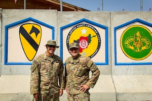 Army Staff Sgt. Mark Szyman, left, and his brother Staff Sgt. Nicholas Szyman are deployed together with the 3rd Cavalry Regiment to the Train, Advise and Assist Command East headquarters in eastern Afghanistan, Sept. 10, 2016. Army photo by Capt. Grace Geiger