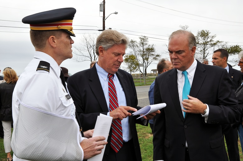 Col. David A. Caldwell, commander, USACE New York District (left), Rep. Frank Pallone (center), and Bob Martin, commissioner, NJDEP (right), discuss plans for Phase 2 of the Hurricane and Storm Damage Reduction Project in Port Monmouth, located in Middletown, N.J.
