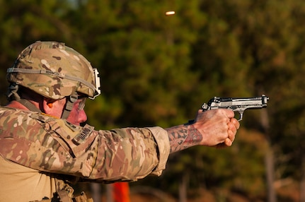 Master Sgt. Robert Mango, with the 9th Mission Support Command and the U.S. Army Reserve Combat Marksmanship Program, engages moving targets on the third day of the U.S. Army Forces Command Weapons Marksmanship Competition Nov. 9, 2016, at Fort Bragg, N.C. The four-day FORSCOM competition features marksmen from the U.S. Army, U.S. Army Reserve, and the National Guard in events for the M9 pistol, the M4A1 rifle and the M249 SAW, or Squad Automatic Weapon, to recognize Soldiers who are beyond expert marksmen. The multi-tiered events challenge the competitors' ability to accurately and quickly engage targets in a variety of conditions and environments. (U.S. Army photo by Timothy L. Hale/Released)