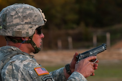 Staff Sgt. Thomas Walsh, with the 744th Engineer Company, 321st Engineer Battalion, engages moving targets in the novice category on the third day of the U.S. Army Forces Command Weapons Marksmanship Competition Nov. 9, 2016, at Fort Bragg, N.C. The four-day FORSCOM competition features marksmen from the U.S. Army, U.S. Army Reserve, and the National Guard in events for the M9 pistol, the M4A1 rifle and the M249 SAW, or Squad Automatic Weapon, to recognize Soldiers who are beyond expert marksmen. The multi-tiered events challenge the competitors' ability to accurately and quickly engage targets in a variety of conditions and environments. (U.S. Army photo by Timothy L. Hale/Released)