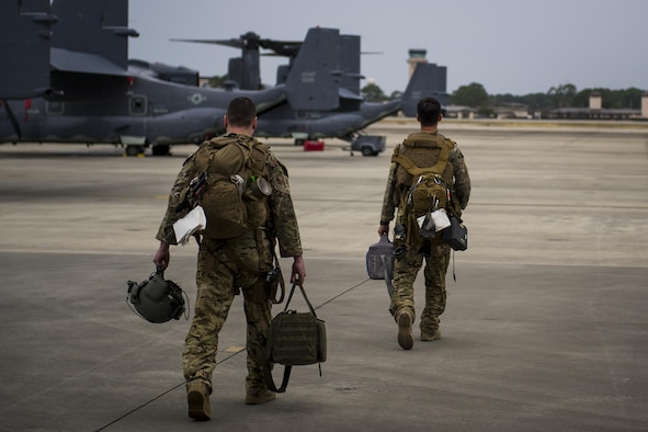 Flight engineers with the 8th Special Operations Squadron, walk to a CV-22 Osprey tiltrotor aircraft at Hurlburt Field, Fla., Nov. 8, 2016. Flight engineers perform pre-flight inspections of aircraft and monitor their engines and other critical flight systems while flying. (U.S. Air Force photo by Airman 1st Class Joseph Pick)