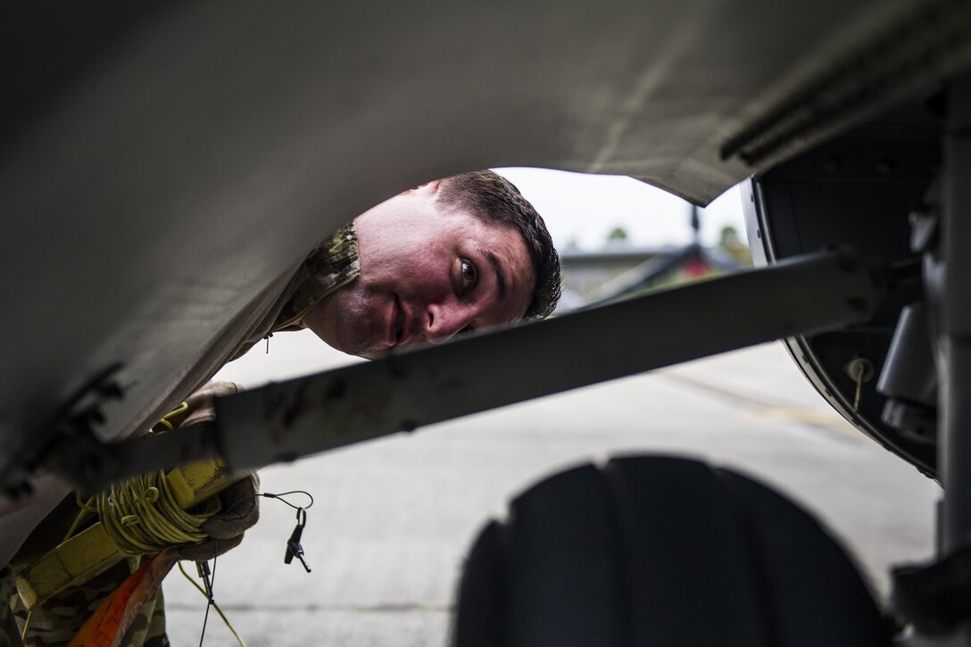 A flight engineer with the 8th Special Operations Squadron inspects the landing gear of a CV-22 Osprey tiltrotor aircraft at Hurlburt Field, Fla., Nov. 8, 2016. Pre-flight inspections are done to check for any issues that may interfere with the flight mission. (U.S. Air Force photo by Airman 1st Class Joseph Pick)