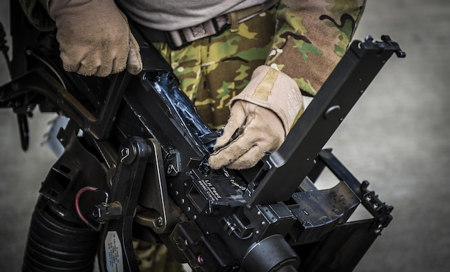 A flight engineer with the 8th Special Operations Squadron checks the bolt of a .50-caliber machine gun at Hurlburt Field, Fla., Nov. 8, 2016. The .50-caliber machine gun weighs more than 80 pounds and is capable of firing up to 850 rounds per minute with a maximum range of approximately 7,400 yards. (U.S. Air Force photo by Airman 1st Class Joseph Pick)