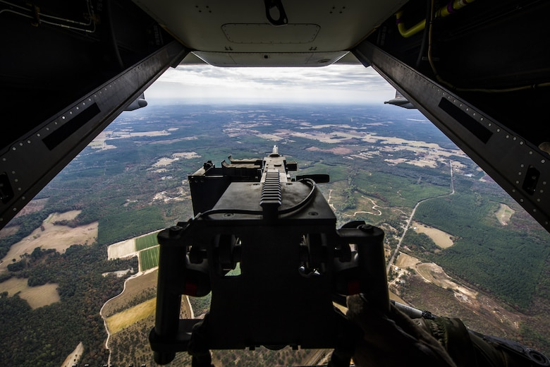 A flight engineer with the 8th Special Operations Squadron grips a .50-caliber machine gun during a CV-22 Osprey tiltrotor aircraft's flight over Alabama, Nov. 8, 2016. The .50-caliber machine gun weighs more than 80 pounds and is capable of firing up to 850 rounds per minute with a maximum range of approximately 7,400 yards. (U.S. Air Force photo by Airman 1st Class Joseph Pick)