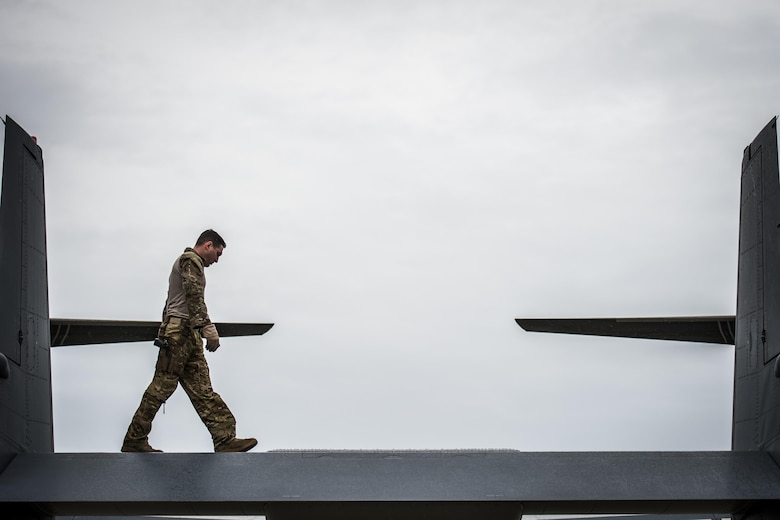 A flight engineer with the 8th Special Operations Squadron conducts pre-flight inspections of a CV-22 Osprey tiltrotor aircraft at Hurlburt Field, Fla., Nov. 8, 2016. Pre-flight inspections are done to check for any issues that may interfere with the flight mission. (U.S. Air Force photo by Airman 1st Class Joseph Pick)