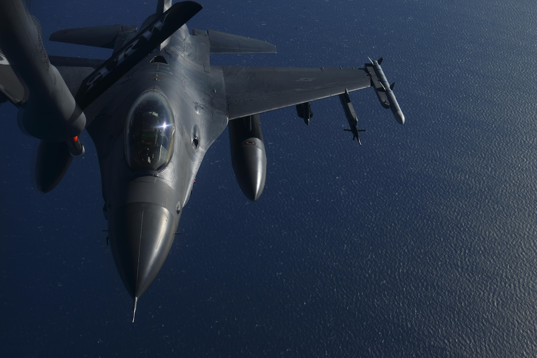 A U.S. Air Force F-16 Fighting Falcon assigned to the 31st Fighter Wing, Aviano Air Base, Italy, prepares to take fuel over the Mediterranean Sea from a KC-135 Stratotanker assigned to the 100th Air Refueling Wing, RAF Mildenhall, England, during Exercise Tonnerre Lighting Nov. 9, 2016. Tonnerre Lightning is a trilateral exercise with France and the U.K. that has taken place biannually since 2014. The training focuses on refining communication procedures while building interoperability capabilities and readiness to conduct combined air operations. (U.S. Air Force photo by Staff Sgt. Micaiah Anthony)
