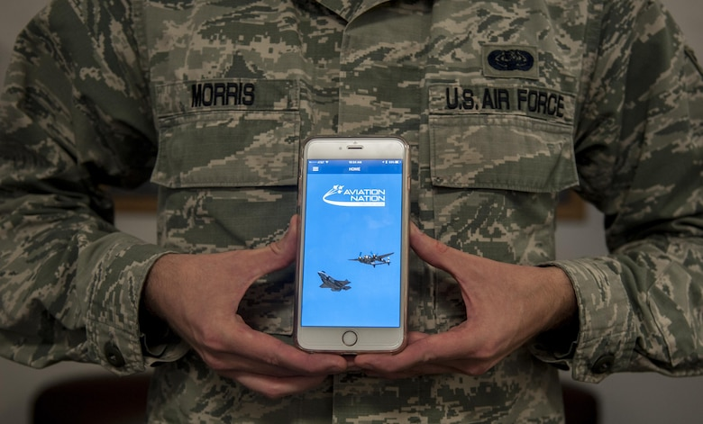 Staff Sgt. Michael Morris, 99th Communications Squadron base content manager, displays the application that he designed for the Aviation Nation Air Show at Nellis Air Force Base, Nev., Nov. 9, 2016. This will be the first year Nellis AFB will have an app available for download specifically for the air show. (U.S. Air Force photo by Airman 1st Class Kevin Tanenbaum/Released)