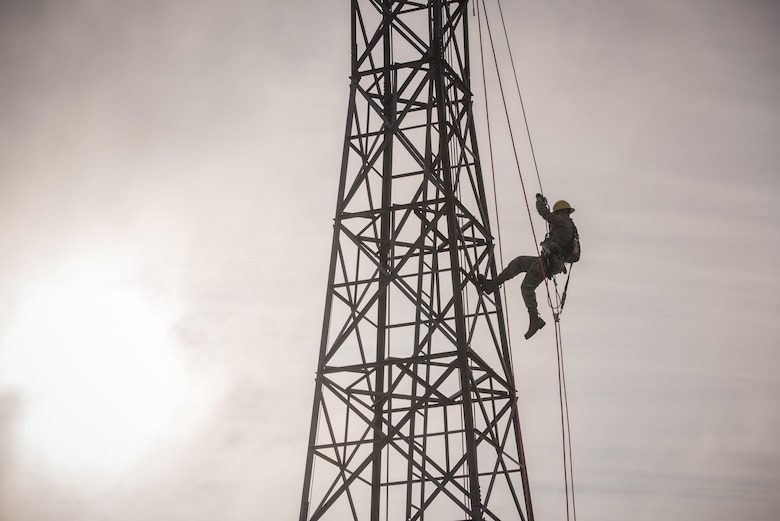 An Air National Guard member, from the 219th Engineering Installation Squadron, performs tower rappelling techniques during an exercise Nov. 4, 2016.  The mission of the 219th EIS is to recruit, train and retain competent professionals to engineer, install, relocate and sustain communications computer systems and services for the nation, state and community during peacetime, national emergencies, natural disasters and war. (U.S. Air National Guard photo/Tech. Sgt. Drew A. Egnoske)