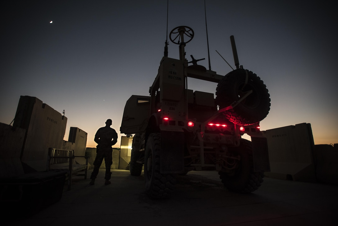 Senior Airman Tyler Phillips, a 451st Expeditionary Support Squadron response force member, monitors his team's security sector at Kandahar Airfield, Afghanistan, Nov. 5, 2016. Response force teams are posted around the airfield to ensure 360-degree security. (U.S. Air Force photo/Staff Sgt. Katherine Spessa)