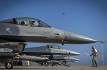 F-16 Fighting Falcon pilots prepare for takeoff on the flightline at Camp Lemonnier, Djibouti, Nov. 6, 2016. The F-16s were conducting close air support training. (U.S. Air Force photo/Staff Sgt. Kenneth W. Norman)