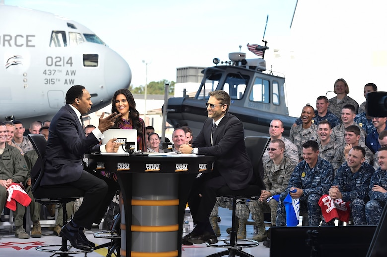 Stephen A. Smith, Molly Qerim and Max Kellerman, from ESPN's First Take, debate sports topics during a live broadcast from Joint Base Charleston, S.C., Nov. 7, 2016. Every year, in honor of Veterans Day, ESPN's First Take pays tribute to service members by telecasting their show from different bases and highlighting those who go above and beyond in their job and on the athletic field. (U.S. Air Force photo/Airman Megan Munoz)