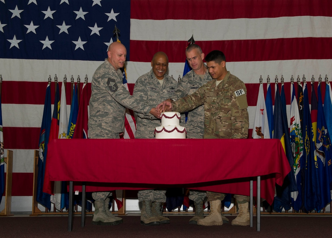 Maj. Gen. Anthony Cotton, 20th Air Force commander, and Col. Colin Connor, 91st Missile Wing commander, cut the 91MW birthday cake with the wing's oldest and youngest Airmen at Minot Air Force Base, N.D., Nov. 9, 2016. The event celebrated the wing's 68th year in service. (U.S. Air Force photos/Senior Airman Apryl Hall)