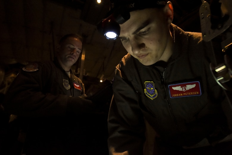 (From left) U.S. Air Force Tech. Sgt. Jacob Appleby, 375th Aeromedical Evacuation Squadron air evacuation technician, watches as U.S. Air Force Capt. Jordan Petersen, 375th AES flight nurse, performs pre-flight checks during exercise Tropical Storm Greg, Nov. 8, 2016, at Little Rock Air Force Base, Ark. The exercise was an example of how the U.S. Air Force provides support to local, state and federal authorities by continuing to play a prominent role in devising the strategies employed. (U.S. Air Force photo by Senior Airman Stephanie Serrano)