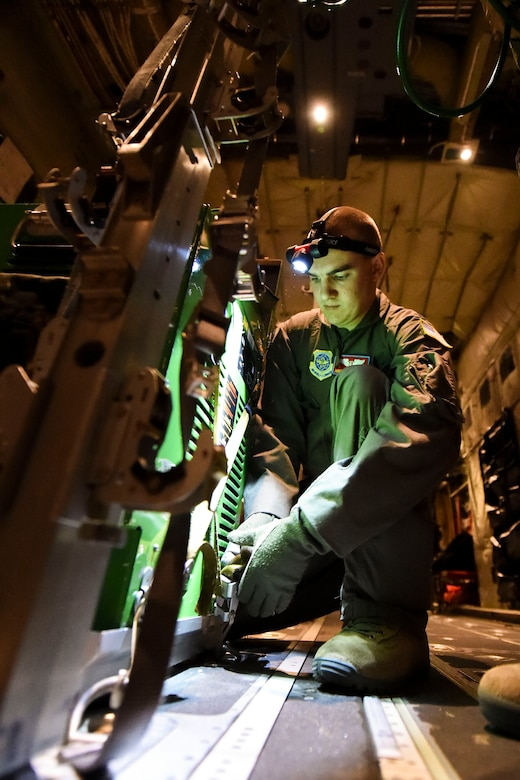 U.S. Air Force Capt. Jordan Petersen, 375th Aeromedical Evacuation Squadron flight nurse, pre-flight checks the Next Generation Portable Therapeutic Liquid Oxygen System, during exercise Tropical Storm Greg, Nov. 8, 2016, at Little Rock Air Force Base, Ark. Medical crews use this system to provide oxygen to patients during emergency aerial transportation. (U.S. Air Force photo by Senior Airman Stephanie Serrano)