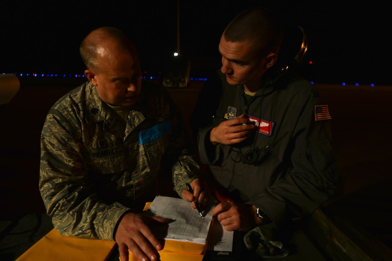 (From left) U.S. Air Force Lt. Col. Russ Frantz, 375th Aeromedical Squadron commander, acts as a federal emergency management agency member to brief U.S. Air Force Capt. Jordan Petersen, 375th Aeromedical Evacuation Squadron flight nurse, on patient care and procedures during exercise Tropical Storm Greg, Nov. 8, 2016, at Alexandria, Louisiana. The 375th AES team members created plans for transporting patients and their specific needs.  (U.S. Air Force photo by Airman Grace Nichols)