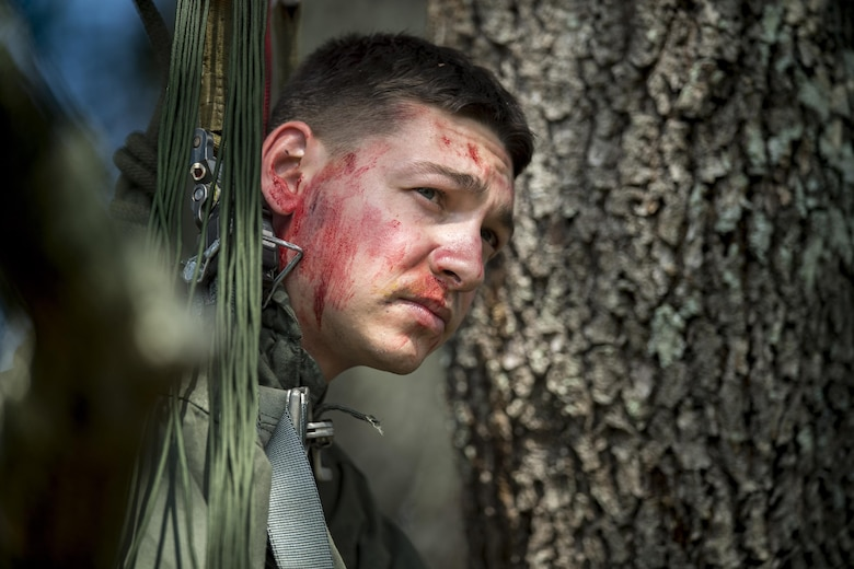 Senior Airman Joshua Barich, 337th Air Control Squadron weapons technician, hangs in a tree to simulate a rescue victim who is stuck, Nov. 2, 2016, in Marianna, Fla. Pararescuemen had to climb the tree, lower Barich down and then assess his condition as part of the rapid-rescue exercise. (U.S. Air Force photo by Tech. Sgt. Zachary Wolf)