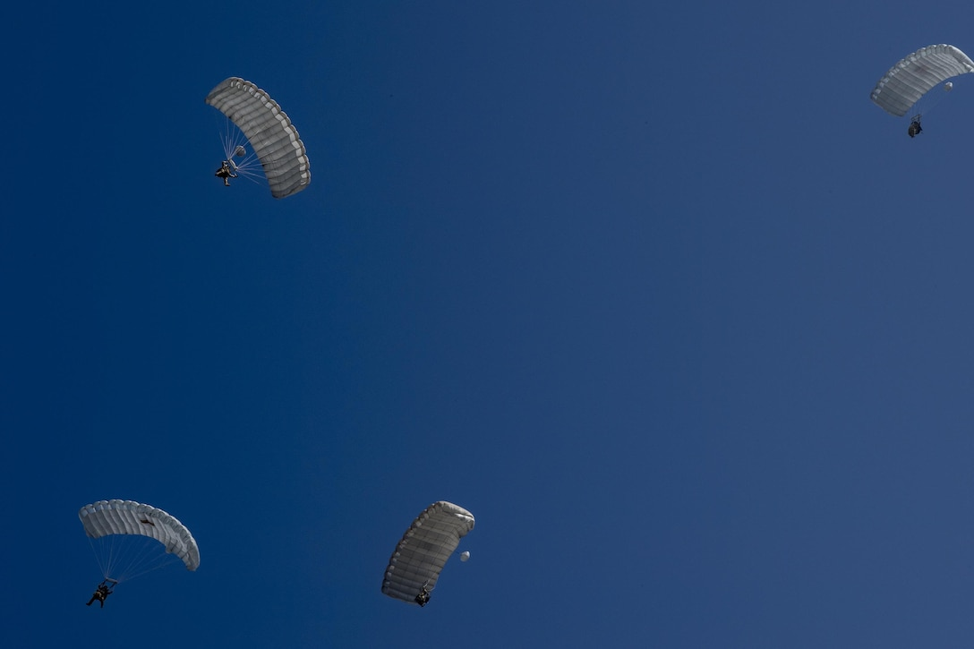 Pararescuemen from the 38th Rescue Squadron parachute towards the ground during a rapid-rescue exercise, Nov. 2, 2016, in Marianna, Fla. The exercise was designed to test the 347th Rescue Group's ability to rapidly deploy, plan and execute rescue operations in combat environments. The exercise included HC-130J Combat King IIs, HH-60G Pave Hawks, C-17 Globemaster IIIs, A-10C Thunderbolt IIs, E-8C Joint Stars, pararescuemen and maintenance, intelligence and support personnel. (U.S. Air Force photo by Tech. Sgt. Zachary Wolf)