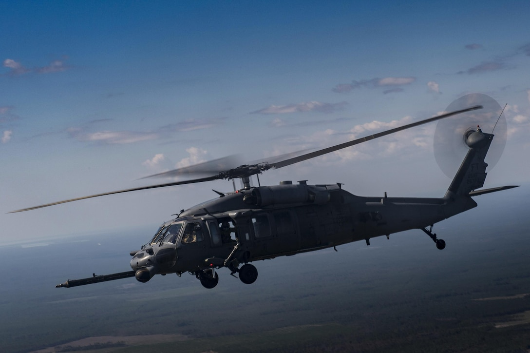 An HH-60G Pave Hawk from the 41st Rescue Squadron flies through the air during a rapid-rescue exercise, Nov. 3, 2016, near Tyndall Air Force Base, Fla. The exercise was designed to test the 347th Rescue Group's ability to rapidly deploy, plan and execute rescue operations in combat environments. The exercise included HC-130J Combat King IIs, HH-60G Pave Hawks, C-17 Globemaster IIIs, A-10C Thunderbolt IIs, E-8C Joint Stars, pararescuemen and maintenance, intelligence and support personnel. (U.S. Air Force photo by Tech. Sgt. Zachary Wolf)