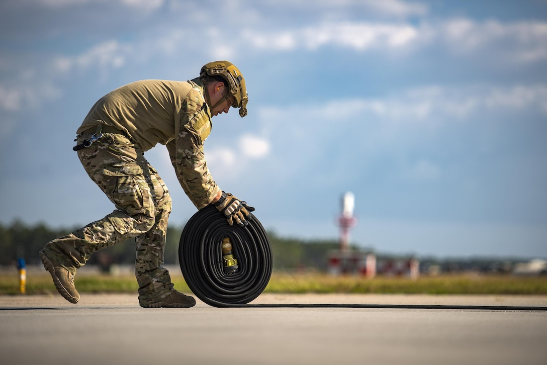 Staff Sgt. Christopher Dessi, 23d Logistics Readiness Squadron forward area refueling point team member, rolls up a hose after refueling an A-10C Thunderbolt II aircraft during a rapid-rescue exercise, Nov. 3, 2016, at Tyndall Air Force Base, Fla.  Moody's FARP team is one of only two in Air Combat Command and allows the HC-130J Combat King II to fly into any airfield and refuel aircraft on the ground so they can quickly return to the fight. (U.S. Air Force photo by Staff Sgt. Ryan Callaghan)