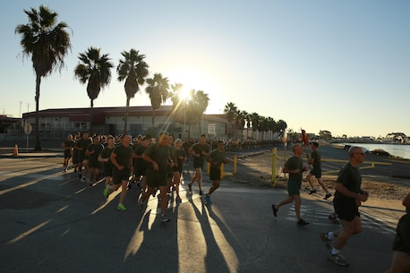 Marines and Sailors with I Marine Expeditionary Force conduct a motivational run at Marine Corps Base Camp Pendleton, Calif., Nov. 10, 2016. The motivational run was done in celebration of the 241st birthday of the United States Marine Corps. On Nov. 1, 1921, General John A. Lejeune, 13th Commandant of the Marine Corps, directed that Marines throughout the globe would celebrate their traditions on the Marine Corps Birthday, Nov. 10.  (U.S. Marine Corps photo by Pfc. Robert Bliss)