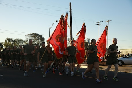 Col. Roberta Shea, commanding officer, I Marine Expeditionary Force Headquarters Group, and Sgt. Maj. David Wilson, sergeant major, I MHG, lead Marines in a motivational run at Marine Corps Base Camp Pendleton, Calif., Nov. 10, 2016. The run was done in celebration of the 241st birthday of the United States Marine Corps. The run is a tradition that is conducted every year prior to the I MEF and I MHG Birthday Ball held later in the evening. (U.S. Marine Corps photo by Pfc. Robert Bliss)