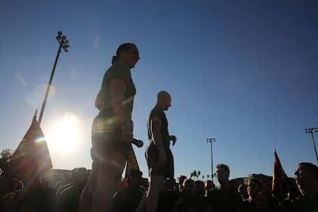 Col. Roberta Shea, commanding officer, I Marine Expeditionary Force Headquarters Group, and Sgt. Maj. David Wilson, sergeant major, I MHG, address Marines and Sailors after a motivational run at Marine Corps Base Camp Pendleton, Calif., Nov. 10, 2016. The motivational run was done in celebration of the 241st birthday of the United States Marine Corps. On Nov. 1, 1921, General John A. Lejeune, 13th Commandant of the Marine Corps, directed that Marines throughout the globe would celebrate their traditions on the Marine Corps Birthday, Nov. 10.  (U.S. Marine Corps photo by Pfc. Robert Bliss)