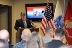 Defense Contract Management Agency Deputy Director James Russell delivers the opening address at the agency headquarters Veterans Day ceremony Nov. 7. The program was in honor of the sacrifice and service of the almost 5,400 veterans across the agency.