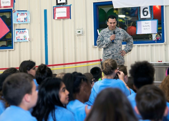 "Master Sgt. Joe Ugarte, 802nd Force Support Squadron Military Family Readiness Center Readiness NCO, speaks to students during Operation Flags at Randolph Elementary School May 18, 2016 at Joint Base San Antonio. About 300 third-, fourth- and fifth-graders from Randolph Elementary School accomplished a special ""mission"" called Operation FLAGS where they experienced what it's like for their active-duty parents to leave for a deployment."