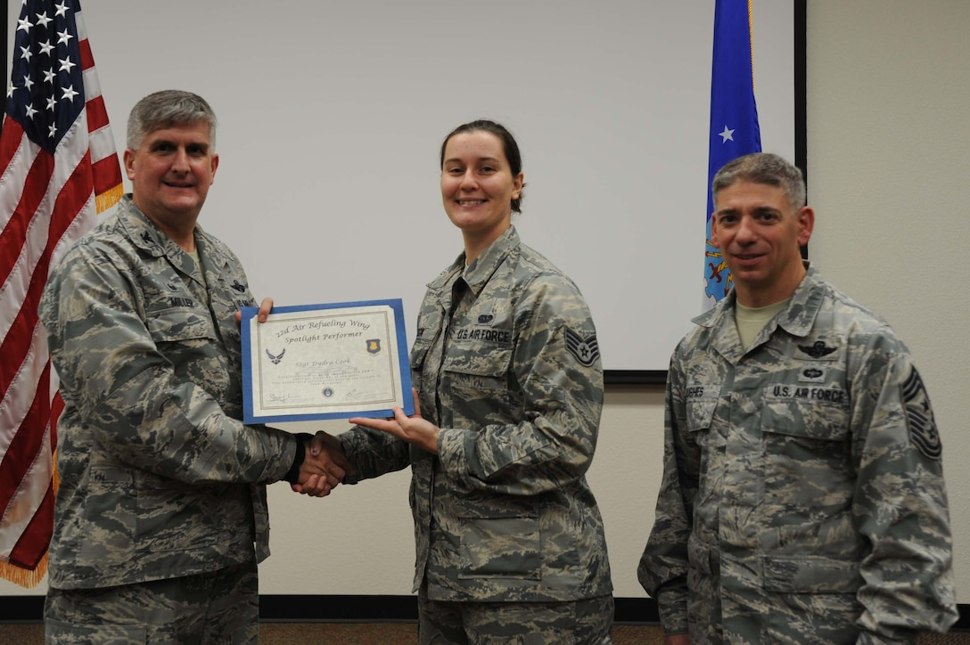 Staff Sgt. Dydra Cook, 22nd Operations Group special operations communications journeyman, poses with Col. Albert Miller, 22nd Air Refueling Wing commander, and Chief Master Sgt. Shawn Hughes, 22nd ARW command chief, Oct. 31, 2016, at McConnell Air Force Base, Kan. Staff Sgt. Cook received the spotlight performer for the week of Oct. 10-14. (U.S. Air Force photo/Staff Sgt. Rachel Waller)